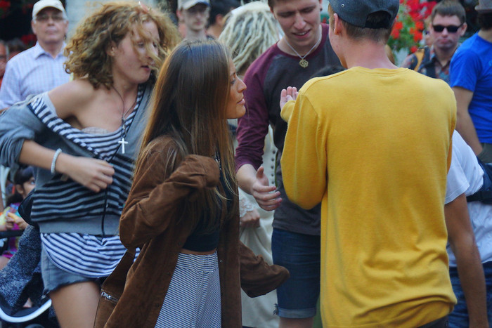 Young people dancing to medieval music in the streets of Tallinn, Estonia.