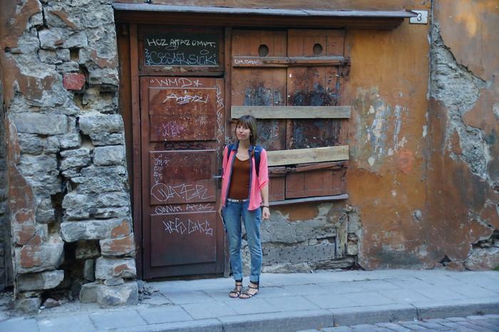 Crumbling stone walls and boarded up doors in Tallinn, Estonia.