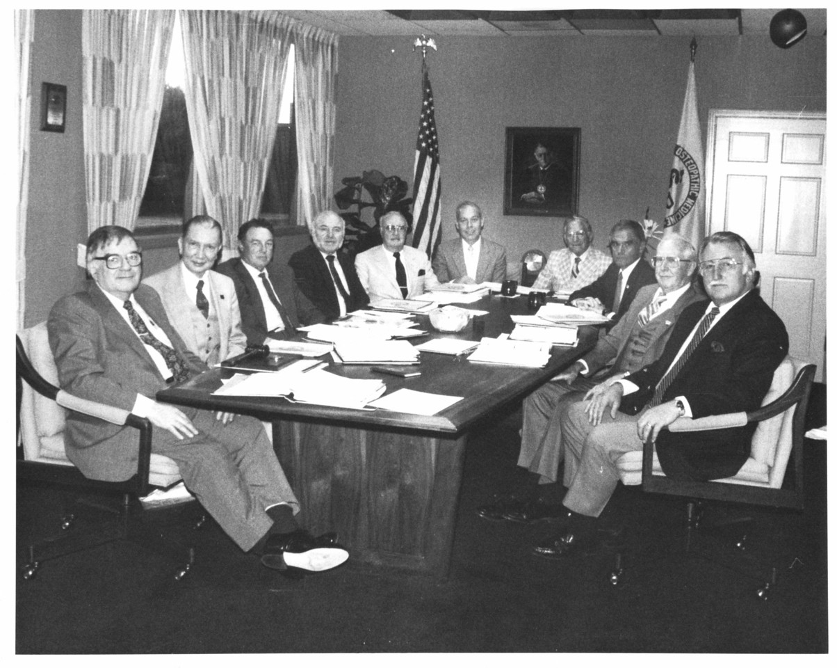 Board of Drectors Meeting 1987 - Warren Lawless, MD, Wesley Boudette, DO, Vice Chair, Ethan Allen, DO, Treasurer, Robert Beloud, Lawrence Leyba, DO, Richard Ebay, DO, Arthur Madorsky, MD, Joseph Gendron, and  President Philip Pumerantz