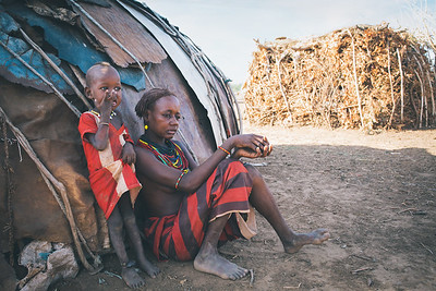 Dasanesh woman with child in Omorate, Omo Valley, Ethiopia