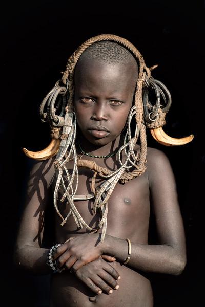 Mursi child adorned