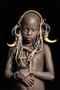 Mursi child adorned