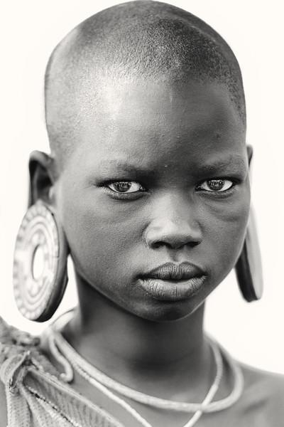 Suri girl with plugged earlobes, Kibish