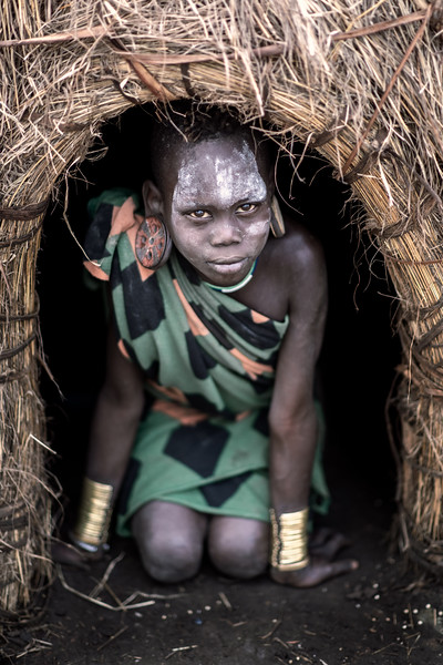 Mursi girl in doorway