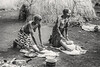 Mursi women grinding flour, Mago