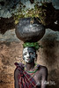 Suri woman with clay pot