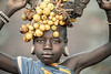 Young Mursi girl adorned