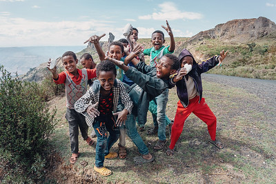 Ethiopian teenager boys posing to tourists