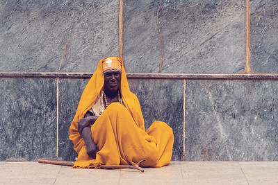 Monk rest in shadow of Church of Our Lady of Zion in Axum