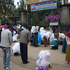 In Addis, midday, services at a church. These people are outside the church and praying.