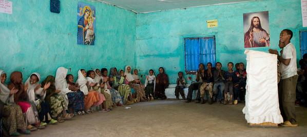 Children singing in a church next to Debre Birhan Selassie