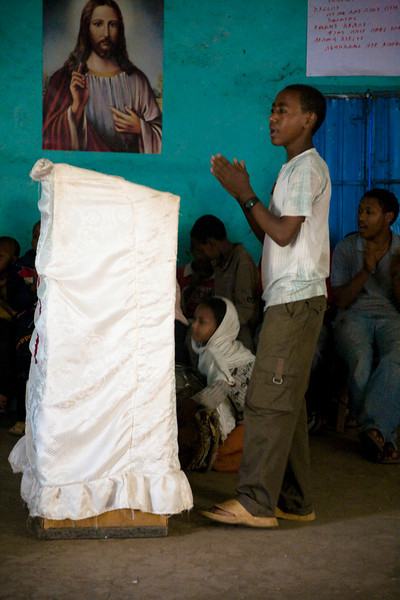 Children singing in a church next to Debre Birhan Selassie - notice the little drummer girl