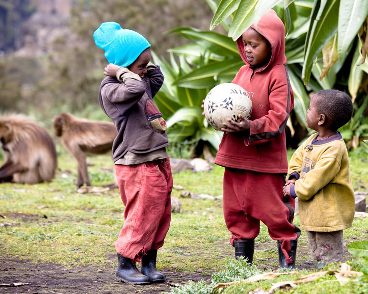 Local kids that just received a beanie and a soccer ball from people in our group