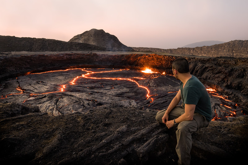 Peering over into the volcanic lake of the Erta Ale Volcano
