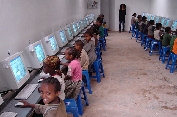 Students in the Computer Lab on the NACOEJ Compound in Addis Ababa, Ethiopia. The lab which has 33 computers is open from 7:00 AM to 7:00 PM to students who attend the Beta Israel Community School. Students can come for three one hour shifts per week. Monitoring the Class is Bethlaham Ashagre (center in black)