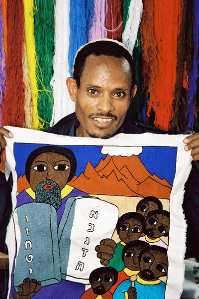 An Embroiderer and member of the Beta Israel Community, displays his unfinished work (Moses with the ten commandments) on the NACOEJ compound for Ethiopian Jews in Addis Ababa Ethiopia