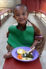 A child eats in the ordinarly crowded Under Six Feeding Center on the NACOEJ Compound in Addis Ababa, Ethiopia
