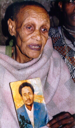 Ethiopian Jewish Woman in Addis Ababa with a photograph of her son in Israel. Ethiopian Jews in Ethiopia and in Israel were often photographed by visitors while holding pictures of their relatives relative in Israel or Ethiopia.