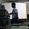Kristi Garabrandt - The News-Herald<br /> Sgt. Barron SWAT/Edge team leader talks about what is required to become a member of SWAT with Junior Police Academy Cadet Jamal Hill Jr.