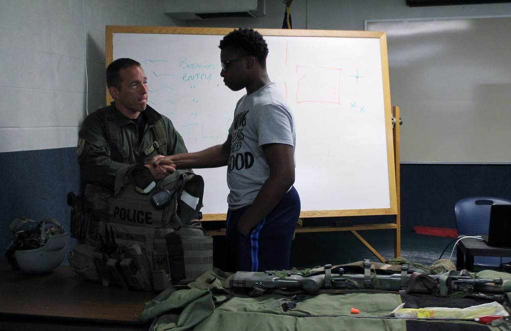 . Kristi Garabrandt - The News-Herald Sgt. Barron SWAT/Edge team leader talks about what is required to become a member of SWAT with Junior Police Academy Cadet Jamal Hill Jr.