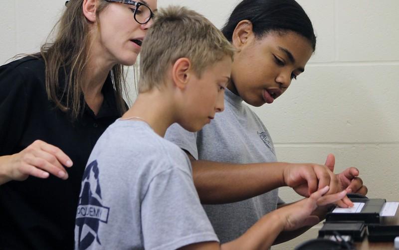 Kristi Garabrandt - The News-Herald<br /> Euclid Det. Jen Kroczak instructs Junior Police Academy Cadets Kaelynn McCauley and Chase Clark on how to take fingerprints.