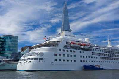 The Sherd behinda cruise ship, Thames, London