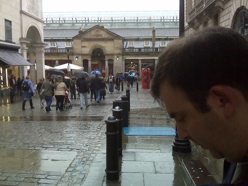 Mike checking his trusty map for the Covent Garden Market (seen in the background). This moment brought to you by Amazing Race.