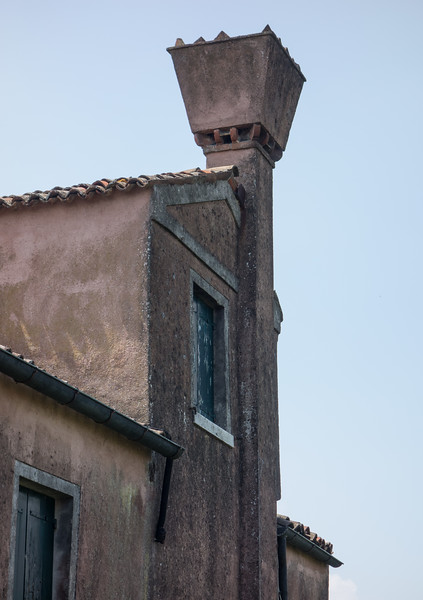 Venice. Traditional chimney design with spark arrester to prevent fire spread.