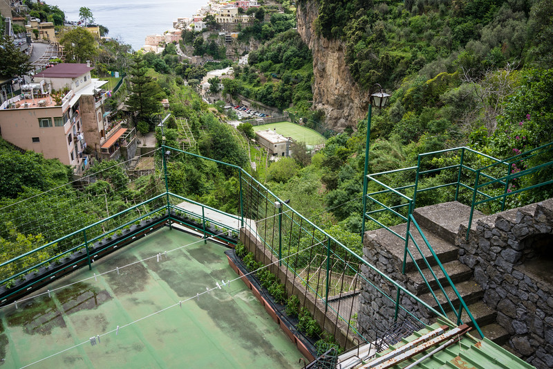 Now that's a spot for a game of tennis! Amalfi coast.