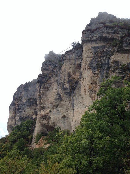 Finally it cleared a bit and we got a better view of the crag. The zip line for the via ferrata can be seen here too.
