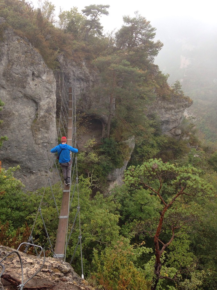 After hanging around for a bit and having lunch we decided the weather probably wasn't going to clear any time soon, so we decided to try the via ferrata. It started with an articulated bridge.