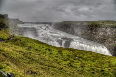 Gullfoss beneath rain and stormy skies.