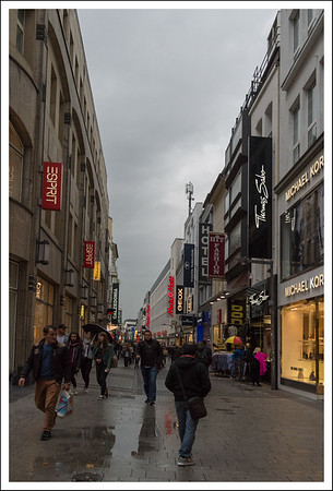 The shopping street, early in the morning during a light drizzle.