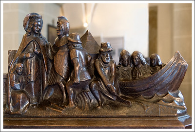 Details from the edge of a pew.  This one also depicts sad looking women in a boat.