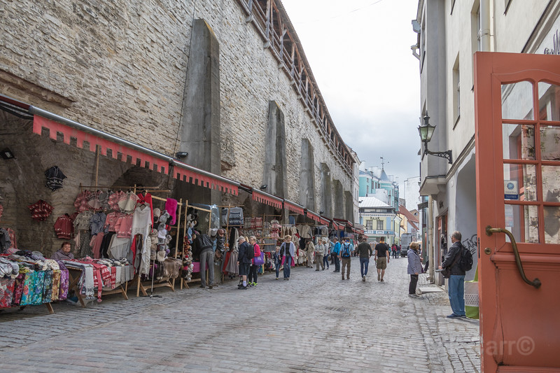 Discover the market shops near the old wall and Viru Gate in medieval Tallinn