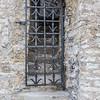 Discover medieval windows in doors of Tallinn, Estonia