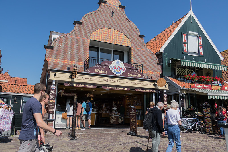 Dutch food - Poffertjes real dutch pancakes - The historic streets of the charming town of Volendam in the Dutch countryside - The historic streets of the charming town of Volendam in the Dutch countryside
