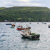 Fishing boats in colourful Scottish town of Portree Harbour on the Isle of Skye, Scotland
