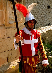 """Guard"" in Knights of Saint John uniform at Fort Saint Elmo during 'In Guardia' reenactment"