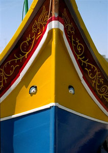 Brightly colored 'luzzu' (fishing boat) with the 'eye of Osiris' on the bow to ward off evil spirits
