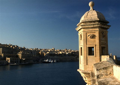 The vedette (guard's tower) at Senglea Point, Valletta in the distance
