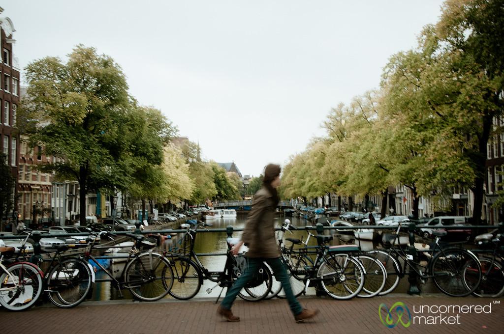 Walking Across Bridge in Amsterdam