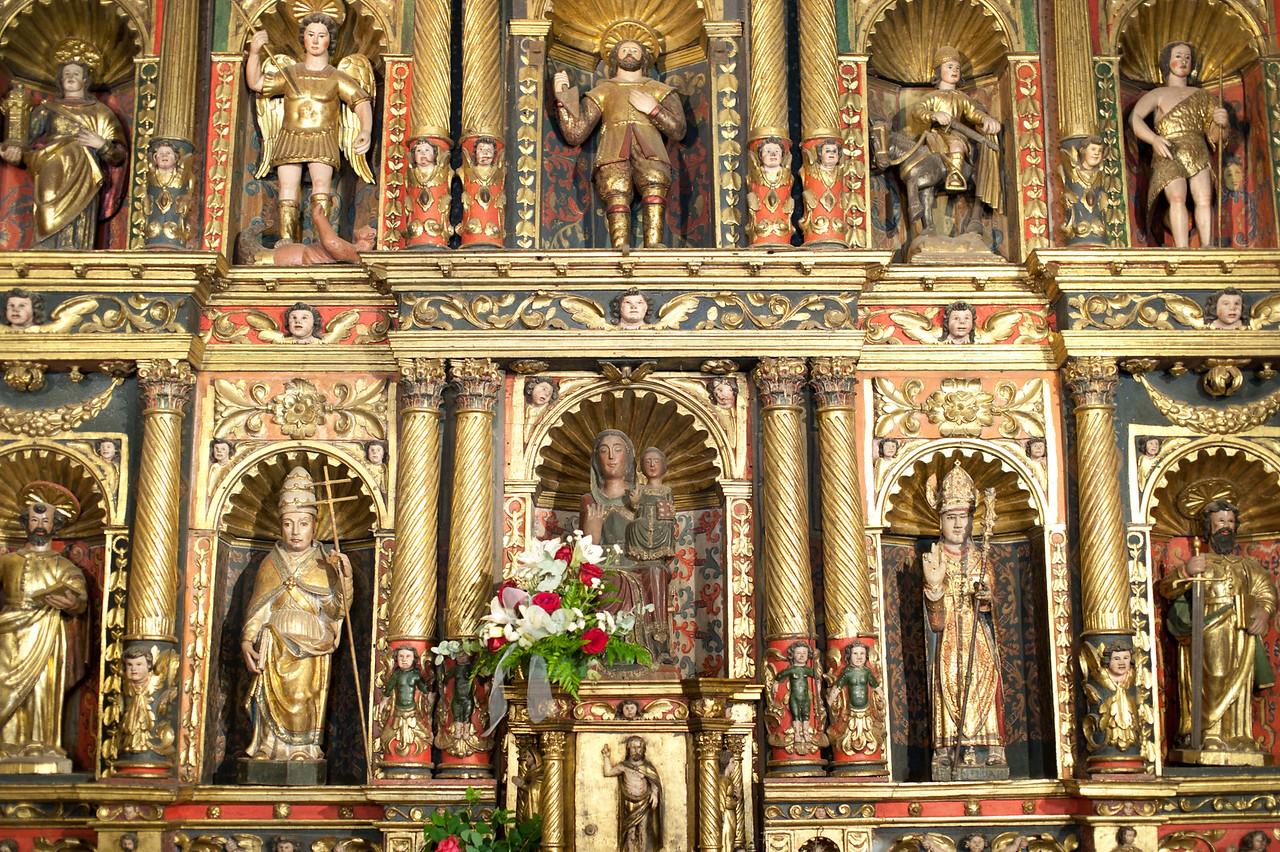 Wide shot of miniature statues inside church in Andorra