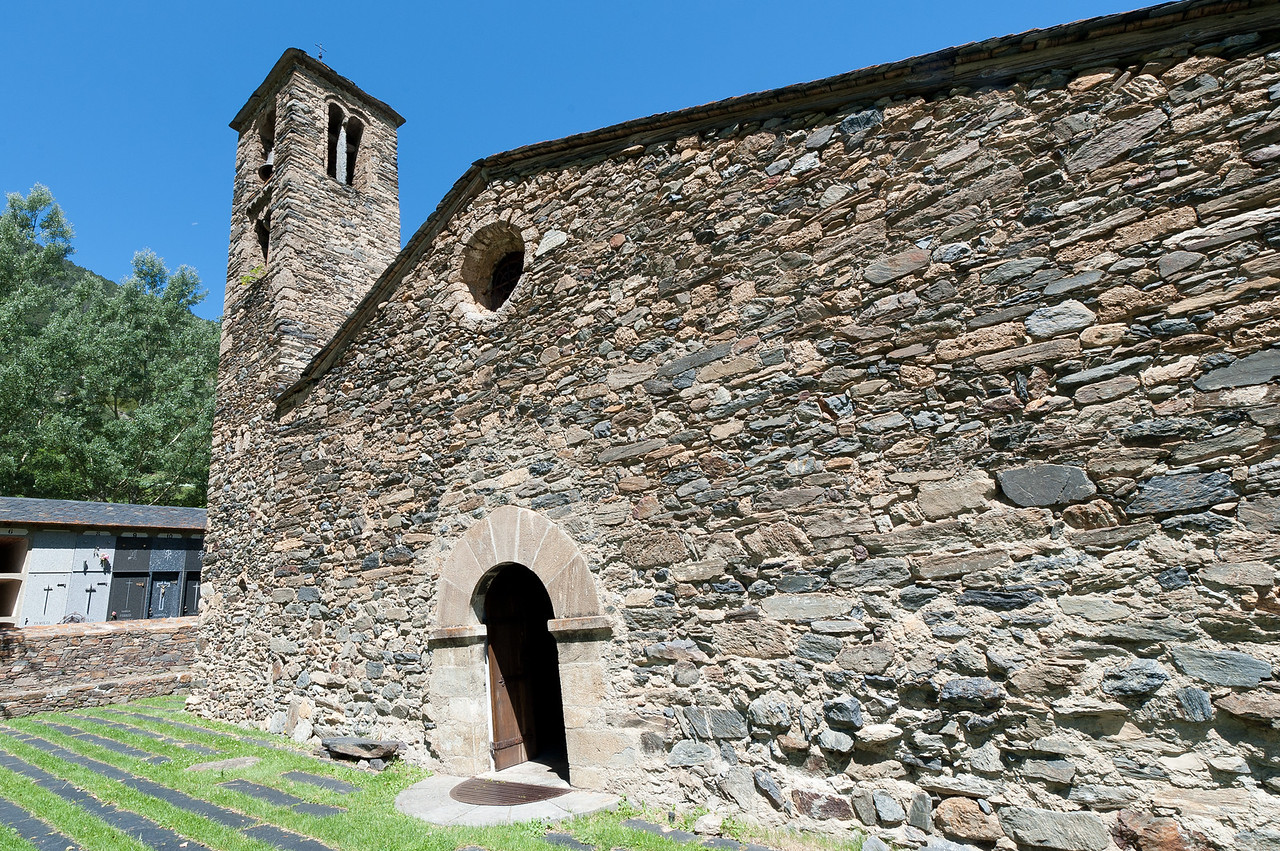 The facade of an old stone church in Andorra