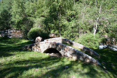 Creek and stone bridge in Andorra