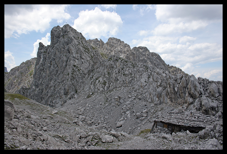 """I walked over a little mound to find this hut at the start of a Ferrata route. A route climbed """"via ferrata"""" means the us of cables and rebar ladders put into difficult sections of the mountain."""