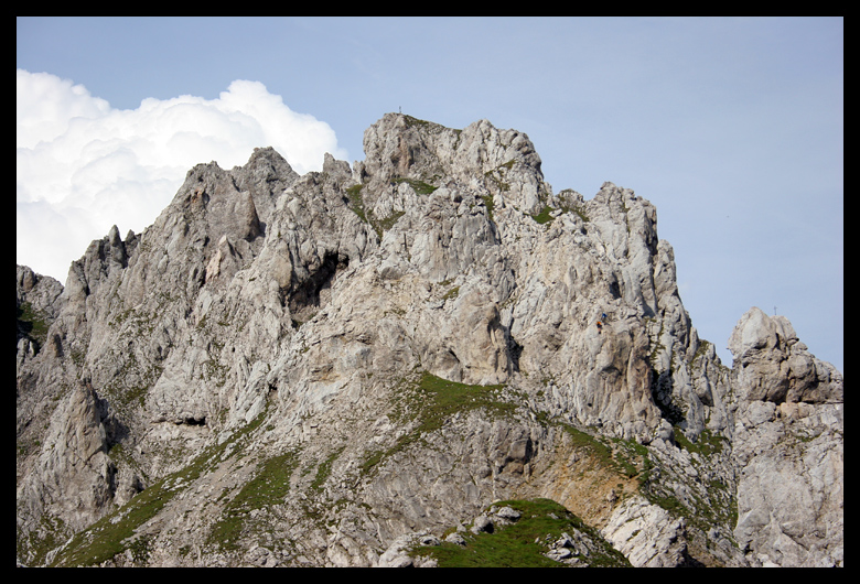 The two climbers are just dots in the mass of rock now as they down climb the most difficult portion of the climb along the ridge. An overhanging ladder.