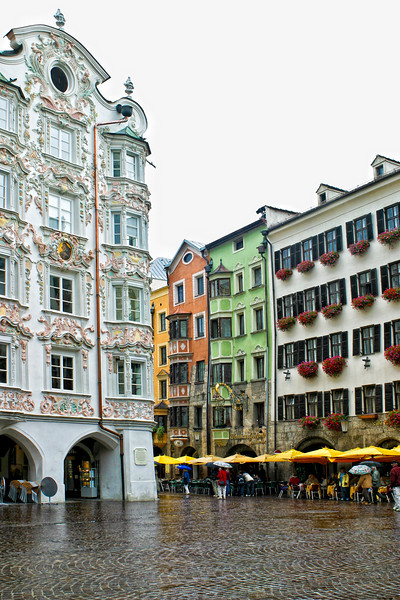 """Innsbruck is the capital city of the federal state of Tyrol in western Austria. It is located in the Inn Valley at the junction with the Wipptal (Sill River), which provides access to the Brenner Pass Located in the broad valley between high mountains, the Nordkette in the north, Patscherkofel and Serles in the south, it is an internationally renowned winter sports centre, and hosted the 1964 and 1976 Winter Olympics and the 1984 and 1988 Winter Paralympics. It is to host the 1st Winter Youth Olympics in 2012. The word bruck comes from the German word Brücke meaning """"bridge"""" which leads to """"the bridge over the Inn""""."""