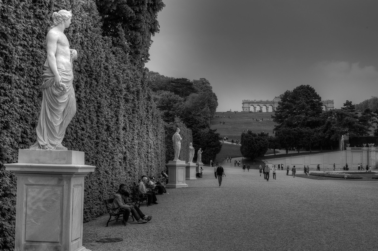 Row of sculptures on Schonbrunn Palace grounds in B&W - Vienna, Austria