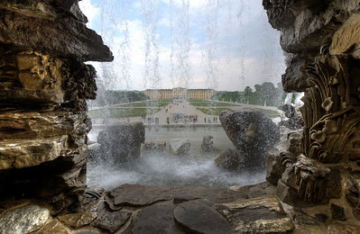 View of the Schonbrunn Palace through fountain - Vienna, Austria